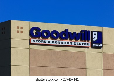 VALENICA, CA/USA - AUGUST 5, 2014: Goodwill store exterior sign. Goodwill Industries is a nonprofit organization that provides job training programs for people with disabilities.