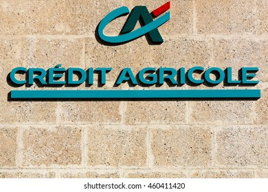 Valensole, France - July 9, 2016: Credit Agricole logo on a wall. Credit Agricole is a French network of cooperative and mutual banks comprising the 39 Credit Agricole Regional Banks