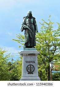 Valentin Vodnik (1758-1819) was a Carniolan priest, journalist and poet of Slovene descent. His bronze statue is the work of the sculptor Alojz Gangl. It stands in the  center of Vodnik Square.