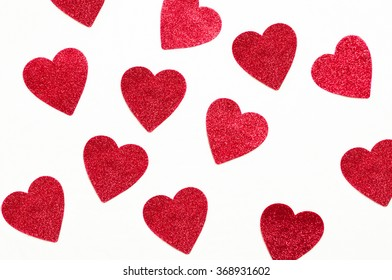 valentine background: red glitter hearts on a white painters canvas background