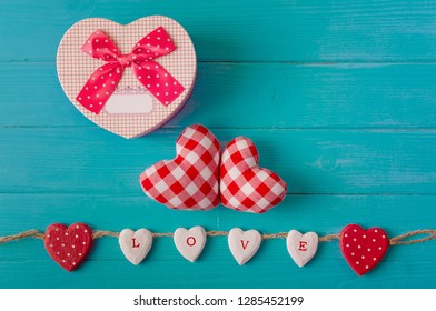 Valentine background with red hearts  and paper card on the wood plank. Happy lovers day.