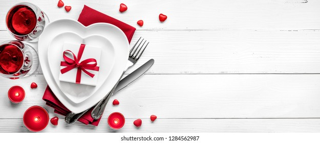 Valentine background with red wine,gifts and chocolates.