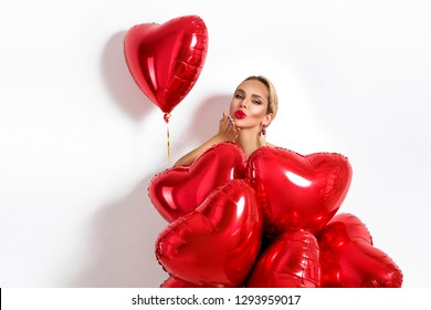 Valentine Beauty girl with red balloon holding hands, isolated on background. Beautiful Happy Young woman sends a kiss. Holiday party, birthday. Joyful model - Image