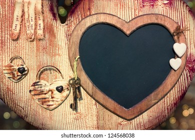 Valentine blackboard frame with keys to the heart and empty space