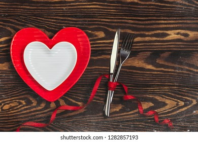 Valentine card with space for text. Dinner table. Love concept for mother's day and valentine's day. Valentine. Love. Valentine's Day postcard. Happy Valentine's day hearts on wooden background.