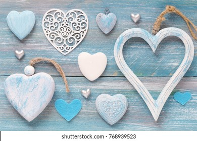 Valentine Day background with many different decorative hearts on wood