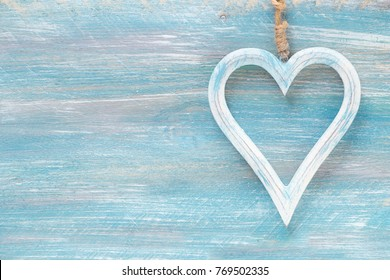 Valentine Day background with variety of decorative hearts on wood with copy space for your text or greeting