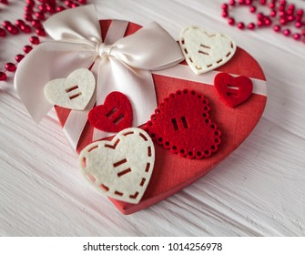 Valentine day composition: white gift boxes with bow and red felt hearts, photo template, background. Top View. View from above.
