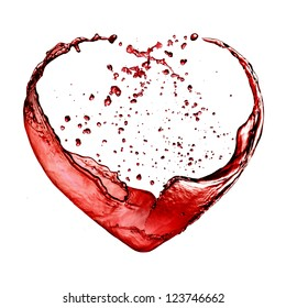 Valentine day heart made of red wine splash isolated on white background