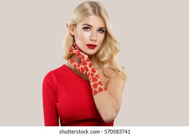 Valentine Day Heart Pink Beauty Woman face Portrait Beautiful Spa model Girl with Perfect Fresh Clean Skin. Blonde model smiling perfect makeup.