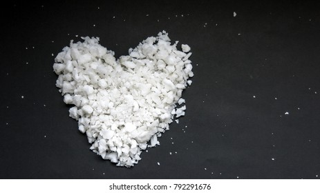 Valentine day heart, heart shape sea salt isolated on black background, close up, cook with love,blank space to edit text.