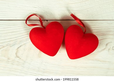 Valentine day. red fabric heart on wooden table