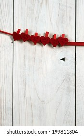 valentine day. red hearts hung on a wooden wall