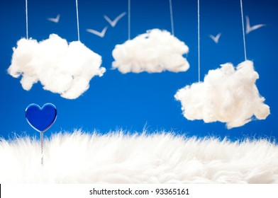 Valentine day theme with blue heart on a spring clouds from cotton wool