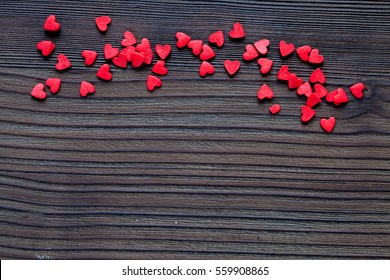 Valentine day wood background with red hearts
