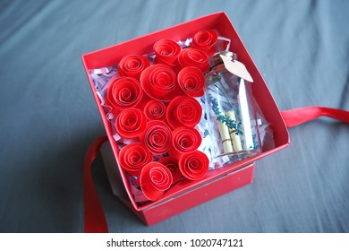 Valentine gift box with paper rose and little bottle, Love concept.
