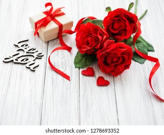 valentine gift box and roses bouquet on a old wooden background