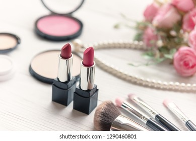 Valentine Gift. Makeup cosmetics tools background and beauty cosmetics, products and facial cosmetics package lipstick with pink rose, Pearl necklace, vintage tone.  Lifestyle and Valentine Concept