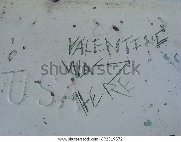Valentine graffiti etched in paint