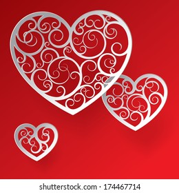 valentine greeting card with tree paper patterned hearts against a red background