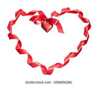 valentine heart from  curled silk red ribbon isolated on white background