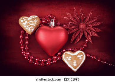 valentine hearts, flower and jewelery on red background