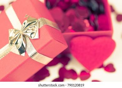 Valentine love gift box and small red hearts confetti