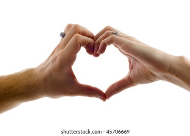 Valentine: Love -  Heart shape being made by a couple, female and male hands together,each wearing a ring, isolated over white background