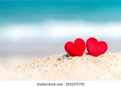 Valentine and Marry Concept.  Two red hearts couple lovers for married wedding in summer day on sand paradise tropical beach, travel blue background.