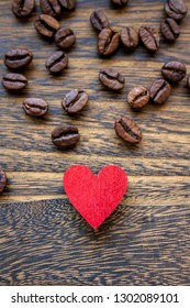 Valentine mood: coffee beans isolated and heart shape on wood background
