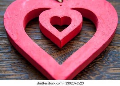 Valentine mood: Heart in heart on wooden background. Heart for wedding.