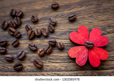 Valentine mood: heart shape flower made of wood and coffee beans