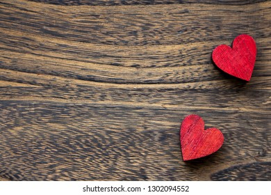 Valentine mood: two red heart shape on wooden background. Heart for wedding.