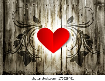 Valentine paper heart on a wood grunge background with floral ornament. Valentine's day card, background, greeting.