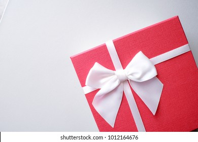 Valentine present. Gift box and red ribbon for romantic couple