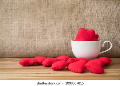 Valentine red hearts in coffee cup, sack and wooden background for coffee shop, wedding, office or people who love coffee  there is copy space for text or signs in vintage styles