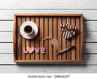 Valentine salver served with cup of coffee, gift box, word love and gift tag.
