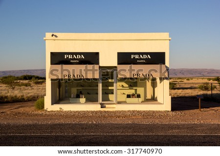 VALENTINE, TEXAS, USA-SEPTEMBER 14: The Marfa Prada sculpture sits on a stretch of US route 90 on September 14, 1015. Prada Marfa is a permanently installed sculpture by artists Elmgreen and Dragset.