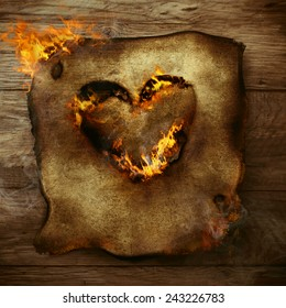 Valentines background. Heart on fire. Burning heart on paper. Valentines greeting card
