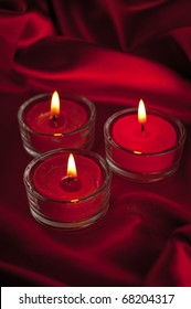 Valentines candles on satin background