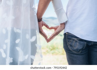 Valentines concept. Holding hands newlyweds wedding couple holding hands.