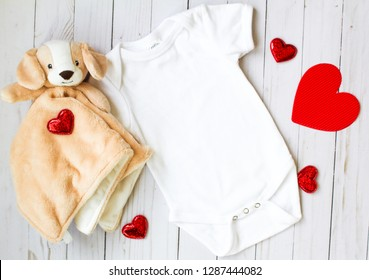 Valentine's Day Baby Onesie Mockup with Hearts and Stuffed Doggy