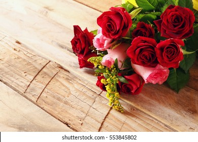 Valentines day background. Beautiful bouquet of roses on wooden table