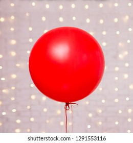 Valentine's day background - big red balloon over white brick wall