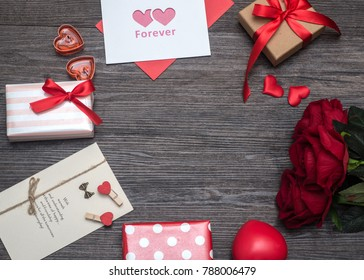 Valentines day background, Valentines day card with roses and gifts on wooden board
