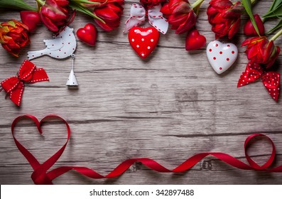 Valentines Day background with chocolates, hearts and red tulips
