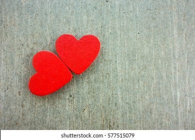 Valentines day background. Couple of red heart on wooden table with copy space