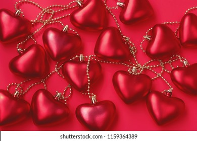 Valentine's day background, garland of scarlet hearts on red paper, mock up for greeting card