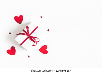 Valentine's Day background. Gift box on white background. Valentines day concept. Flat lay, top view, copy space