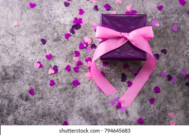 Valentines day background. Gift box and greeting card. Love symbol.